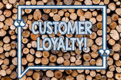 Handwriting text writing Customer Loyalty. Concept meaning Client Satisfaction LongTerm relation Confidence Wooden. Handwriting text writing Customer Loyalty stock photography