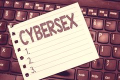 Handwriting text writing Cybersex. Concept meaning sexual arousal using computer technology by wearing vr equipment.  stock images