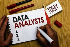 Handwriting text writing Data Analysts. Concept meaning Programmer Design and Create Report Identifies patterns Man holding marker. Notebook clothespin reminder stock images