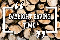 Handwriting text writing Daylight Saving Time. Concept meaning advancing clocks during summer to save electricity Wooden. Handwriting text writing Daylight royalty free stock image