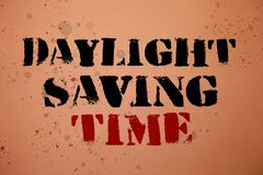 Handwriting text writing Daylight Sayving Time. Concept meaning advancing clocks during summer to save electricity Pink background. Messages thoughts important Stock Photography