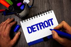 Handwriting text writing Detroit. Concept meaning City in the United States of America Capital of Michigan Motown Man hold holding. Marker notebook ideas stock image