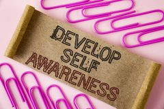 Handwriting text writing Develop Self Awareness. Concept meaning What you think you become motivate and grow written on Folded Car. Handwriting text writing royalty free stock images
