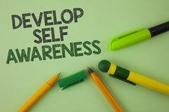 Handwriting text writing Develop Self Awareness. Concept meaning What you think you become motivate and grow written on Plain Gree. Handwriting text writing stock images
