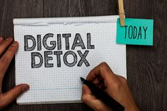 Handwriting text writing Digital Detox. Concept meaning Free of Electronic Devices Disconnect to Reconnect Unplugged Open notebook. Clothespin holding reminder stock images