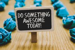 Handwriting text writing Do Something Awesome Today. Concept meaning Make an incredible action motivate yourself Stand. Blackboard with white words behind royalty free stock image