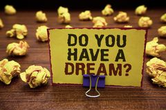 Handwriting text writing Do You Have A Dream question. Concept meaning asking someone about life goals Achievements Yellow sticky. Card clipped text notice Stock Images
