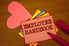 Handwriting text writing Employee Handbook. Concept meaning Document Manual Regulations Rules Guidebook Policy Code Text colorful. Paper notes pink heart red royalty free stock photos