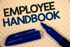 Handwriting text writing Employee Handbook. Concept meaning Document Manual Regulations Rules Guidebook Policy Code Text two Words. Written paper open blue royalty free stock photos