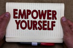 Handwriting text writing Empower Yourself. Concept meaning taking control of life setting goals positive choices Man hands holding. Notebook open page jute Royalty Free Stock Image
