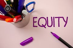 Handwriting text writing Equity. Concept meaning Value of a company divided into equal parts owned by shareholders White backgroun. D purple pen markers ideas royalty free stock image