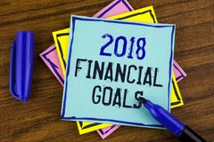 Handwriting text writing 2018 Financial Goals. Concept meaning New business strategy earn more profits less investment written on. Handwriting text writing 2018 Royalty Free Stock Photography