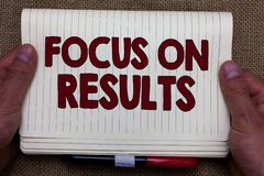 Handwriting text writing Focus On Results. Concept meaning concentrating on certain actions gains and goals Man hands holding note royalty free stock photos