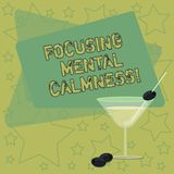 Handwriting text writing Focusing Mental Calmness. Concept meaning free the mind from agitation or any disturbance Filled Cocktail. Wine Glass with Olive on the stock illustration