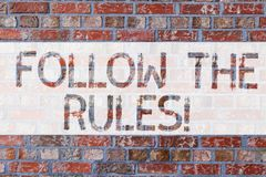 Handwriting text writing Follow The Rules. Concept meaning act in agreement or compliance with obey them Firmly Brick. Wall art like Graffiti motivational call royalty free stock image