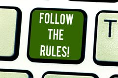 Handwriting text writing Follow The Rules. Concept meaning act in agreement or compliance with obey them Firmly Keyboard. Key Intention to create computer royalty free stock images
