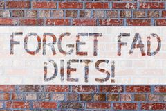 Handwriting text writing Forget Fad Diets. Concept meaning drop pounds due unhealthy calorie reduction or water loss. Brick Wall art like Graffiti motivational royalty free stock photo
