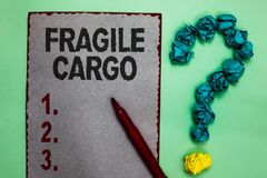 Handwriting text writing Fragile Cargo. Concept meaning Breakable Handle with Care Bubble Wrap Glass Hazardous Goods. Gray paper marker crumpled papers forming royalty free stock photos