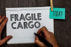 Handwriting text writing Fragile Cargo. Concept meaning Breakable Handle with Care Bubble Wrap Glass Hazardous Goods Open notebook. Clothespin holding reminder royalty free stock photos