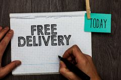 Handwriting text writing Free Delivery. Concept meaning Shipping Package Cargo Courier Distribution Center Fragile Open notebook c. Lothespin holding reminder stock photos