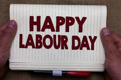 Handwriting text writing Happy Labour Day. Concept meaning annual holiday to celebrate the achievements of workers Man. Hands holding notebook open page jute stock images