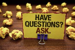 Handwriting text writing Have Questions question Ask.. Concept meaning asking someone respond you with feedback Yellow sticky card. Clipped text notice crumpled Royalty Free Stock Images