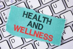 Handwriting text writing Health And Wellness. Concept meaning being in good shape Healthy food workout drink water written on tear. Handwriting text writing Royalty Free Stock Photo