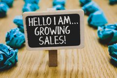 Handwriting text writing Hello I Am... Growing Sales. Concept meaning Making more money Selling larger quantities Stand blackboard. With white words behind stock photography