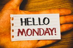 Handwriting text writing Hello Monday Motivational Call. Concept meaning Positive Message for a new day Week Start Text two Words. Written white paper note hand stock photography