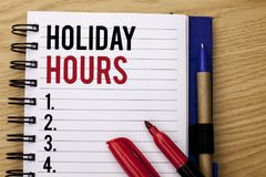 Handwriting text writing Holiday Hours. Concept meaning Celebration Time Seasonal Midnight Sales Extra-Time Opening written on Not stock photos