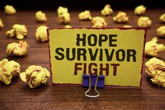 Handwriting text writing Hope Survivor Fight. Concept meaning stand against your illness be fighter stick to dreams Yellow sticky. Card clipped text notice Stock Photo