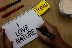 Handwriting text writing I Love Nature. Concept meaning Enjoy the natural environment Preservation Protect ecosystem Man holding m Stock Photos
