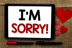 Handwriting text writing I m Sorry. Concept meaning Apologize Conscience Feel Regretful Apologetic Repentant Sorrowful written on. Handwriting text writing I m Royalty Free Stock Photo