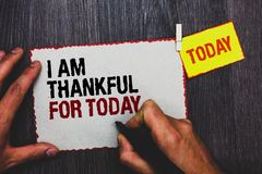 Handwriting text writing I Am Thankful For Today. Concept meaning Grateful about living one more day Philosophy Hand grip black ma. Rker writing text paperclip stock image