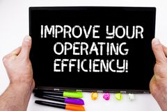 Handwriting text writing Improve Your Operating Efficiency. Concept meaning Make adjustments to be more efficient stock image