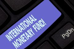 Handwriting text writing International Monetary Fund. Concept meaning promotes international financial stability. Keyboard key Intention to create computer royalty free stock photography
