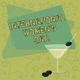 Handwriting text writing International Women S Day. Concept meaning International celebration for womens achievement Filled. Cocktail Wine Glass with Olive on stock illustration