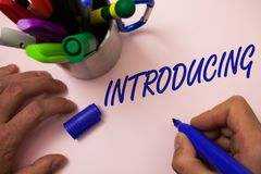 Handwriting text writing Introducing. Concept meaning Presenting a topic or someone Initial approach First meeting Man working ins. Piration holding marker Stock Photography