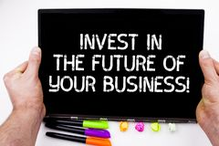 Handwriting text writing Invest In The Future Of Your Business. Concept meaning Make investments to improve company. Handwriting text writing Invest In The royalty free stock photography