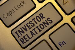 Handwriting text writing Investor Relations. Concept meaning Finance Investment Relationship Negotiate Shareholder Golden keyboard. With jet gray button royalty free stock image