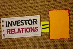 Handwriting text writing Investor Relations. Concept meaning Finance Investment Relationship Negotiate Shareholder Jute sack deck. White page show words red stock photo