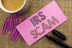 Handwriting text writing Irs Scam. Concept meaning Warning Scam Fraud Tax Pishing Spam Money Revenue Alert Scheme written on Pink Royalty Free Stock Photos