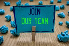 Handwriting text writing Join Our Team. Concept meaning Allied Associate Work with us New Employee Hired Enlist. Clothespin holding blue paper note crumpled stock photography