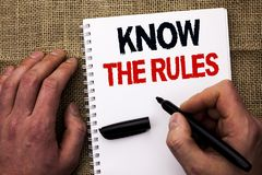 Handwriting text writing Know The Rules. Concept meaning Be aware of the Laws Regulations Protocols Procedures written by Man. Holding Marker Notebook Book the stock photo