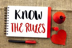 Handwriting text writing Know The Rules. Concept meaning Be aware of the Laws Regulations Protocols Procedures written on Notebook. Handwriting text writing Know stock photography
