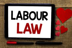 Handwriting text writing Labour Law. Concept meaning Employment Rules Worker Rights Obligations Legislation Union written on Table. Handwriting text writing Stock Images