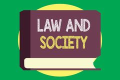 Handwriting text writing Law And Society. Concept meaning Address the mutual relationship between law and society.  stock illustration