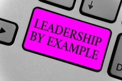 Handwriting text writing Leadership By Example. Concept meaning Becoming role model for people Have great qualities Computer progr. Am input software keyboard stock photo