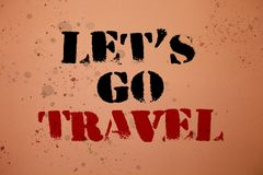 Handwriting text writing Let\'S Go Travel. Concept meaning Going away Travelling Asking someone to go outside Trip Pink background. Messages thoughts important Stock Images