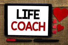 Handwriting text writing Life Coach. Concept meaning Mentoring Guiding Career Guidance Encourage Trainer Mentor written on Tablet. Handwriting text writing Life Stock Photos